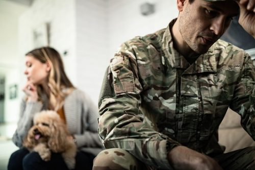 Sad Soldier sits with his back to his sad wife; military court martial appeal