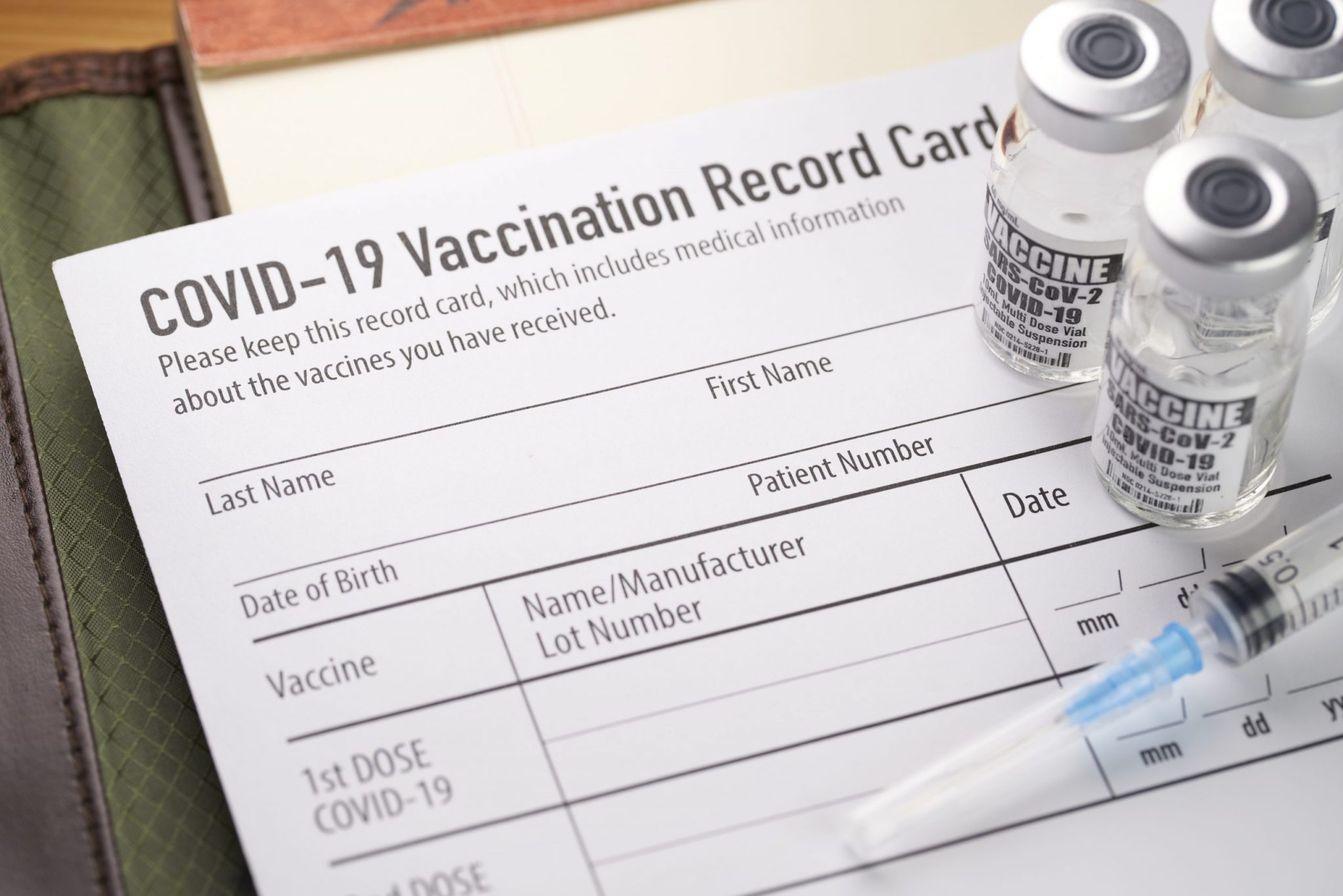 Covid-19 vaccination record card with vials and syringe, Article 92.